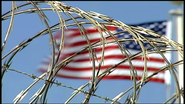 petition calling for release of guantanamo prisoner shaker aamer r12090610 / 1292006 guantanamo bay naval base camp delta low angle shot of american... - prisoner released stock videos & royalty-free footage