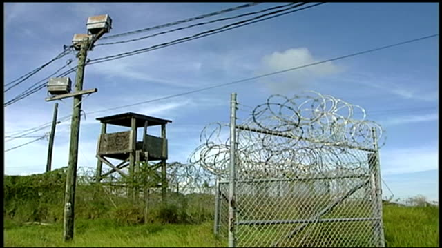 petition calling for release of guantanamo prisoner shaker aamer; r12090610 / 12.9.2006 cuba: guantanamo bay naval base: camp delta ext barbed wire... - petition stock videos & royalty-free footage