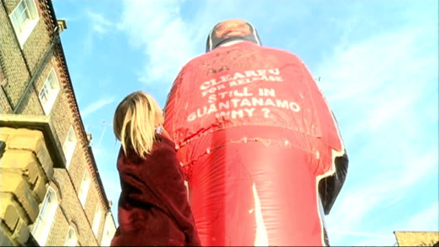 petition calling for release of guantanamo prisoner shaker aamer england london ext activist joanne macinnes standing alongside large inflatable... - shaker aamer stock videos & royalty-free footage
