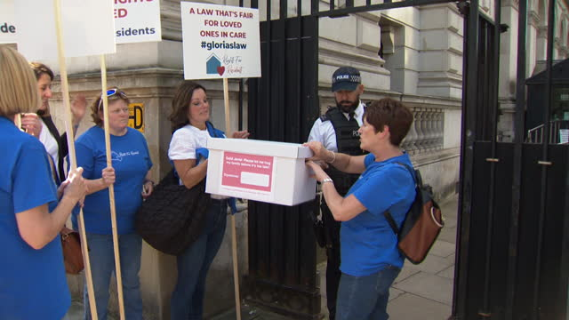 petition delivered to downing street by rights for residents campaigners, families wanting more legal rights about visiting people in care homes,... - politics and government stock videos & royalty-free footage