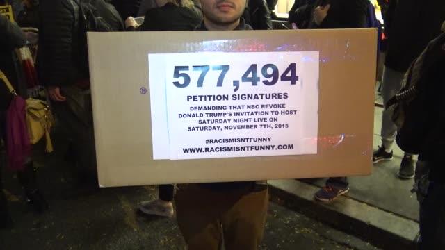 Petition signatures demanding that NBC revoke Donald Trump's invitation to host Saturday Night Live on Saturday November 7 2015 / Demonstrators...