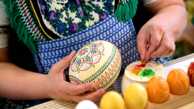 petra nakoinz paints an easter egg during the annual sorbian easter egg market at the sorbian cultural center on march 17 2018 in schleife germany... - annual event stock videos and b-roll footage