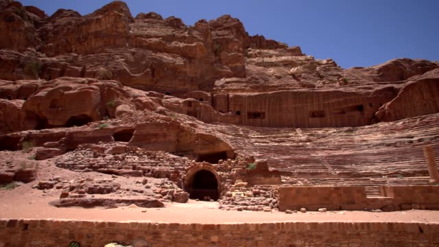 petra - roman theater , jordan. the roman theater, carved out of the rock walls in the ancient 'rose city' of petra, jordan. - 4th century bc stock videos and b-roll footage