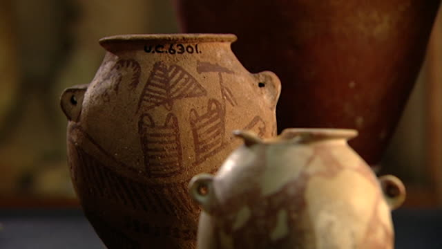 petrie museum. view of predynastic ancient egyptian pots. - pottery stock videos & royalty-free footage