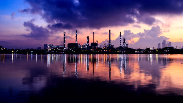 petrochemical oil refinery plant with reflection on the river - refinery stock videos & royalty-free footage