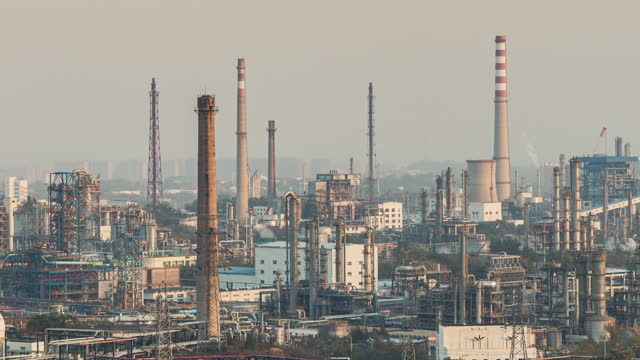 t/l petrochemical plant and oil refinery industry, from day to sunset - day to sunset stock videos & royalty-free footage