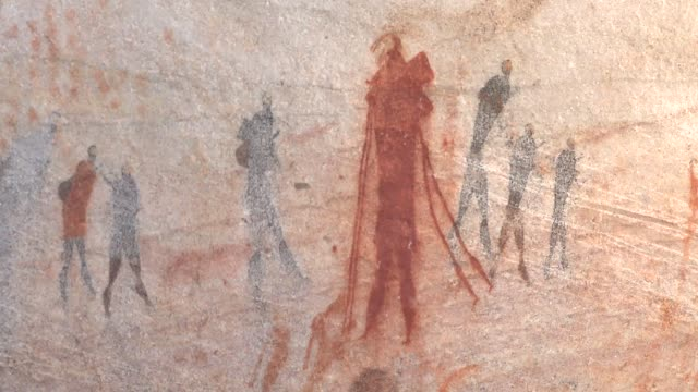 a petroglyph depicts bushmen on a cave wall. available in hd. - cave painting stock videos & royalty-free footage