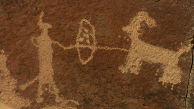 CU, Petroglyph representing hunter and horned animal, Utah, USA