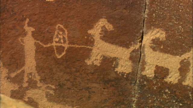 cu, petroglyph representing hunter and horned animals, utah, usa - human representation stock videos & royalty-free footage