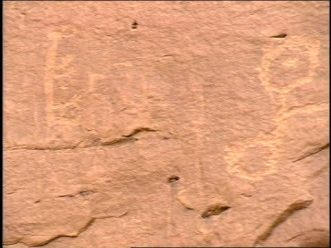 petroglyphs are carved on rocks in chaco canyon. - chaco canyon stock videos & royalty-free footage