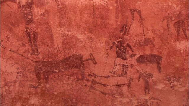 petroglyphs cover a cliff at gilf kebir in the sahara desert. - prehistoric art stock videos & royalty-free footage