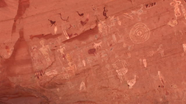 ms pan petroglyphs on wall at blue bull cave/ canyon de chelly national monument, arizona - canyon de chelly stock videos & royalty-free footage