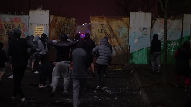 petrol bombs, fireworks and sectarian violence at peace line on springfield road, as tensions rise between loyalist and nationalist youths - fire natural phenomenon stock videos & royalty-free footage