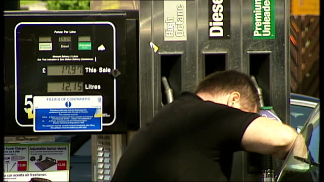 stockvideo's en b-roll-footage met petrol price rises to be examined by office of fair trading various of motorists filling cars with petrol at texaco petrol station general view of... - shell merknaam