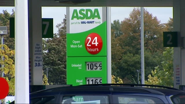 price board at asda forecourt showing unleaded at 1059 - unleaded stock videos and b-roll footage