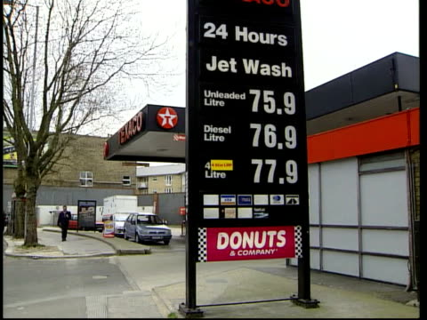 petrol prices increase; petrol prices increase; itn england ext texaco petrol station price sign showing unleaded petrol at 75.9 a litre tilt down... - no doubt band stock videos & royalty-free footage
