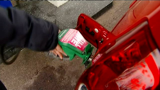cardiff ext top shot car being filled with unleaded petrol - unleaded stock videos and b-roll footage