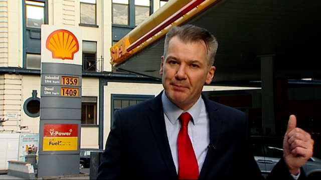 stockvideo's en b-roll-footage met petrol prices set to rise; reporter to camera general view of sainsbury's petrol station close shot of sign showing unleaded petrol price and diesel... - graph