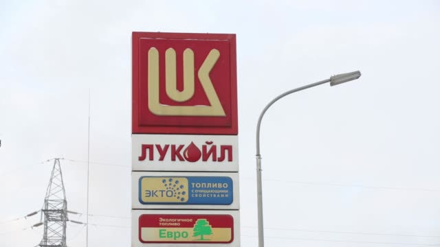 petrol prices sit on an electronic signboard at the entrance to an oao lukoil gas station in moscow, russia, on tuesday, dec 2 gvs of the electronic... - moscow russia video stock e b–roll