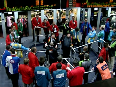 petrol traders wearing brightly coloured jackets stand and trade in pit - loss stock videos & royalty-free footage