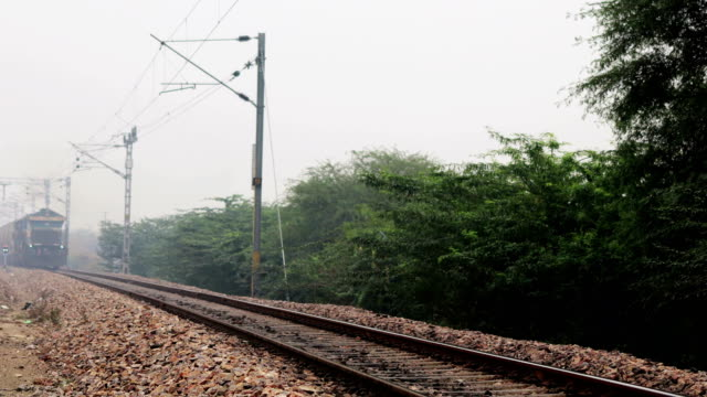 petrol train running on railroad station - trasporto ferroviario video stock e b–roll