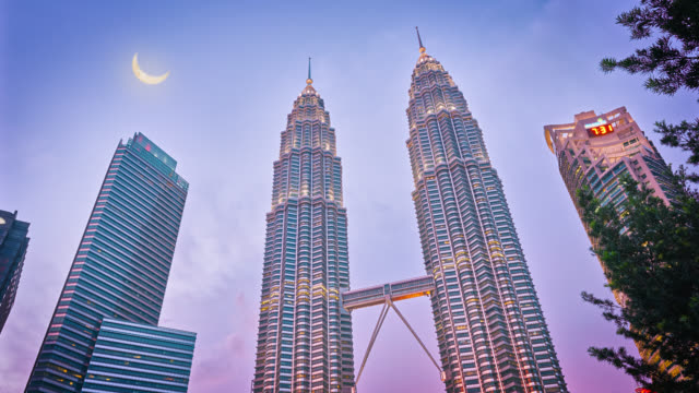 petronas towers at dusk - malaysia stock videos & royalty-free footage
