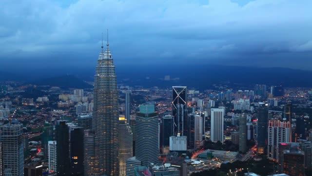 petronas twin towers at night. kuala lumpur, malaysia - menara kuala lumpur tower stock videos & royalty-free footage
