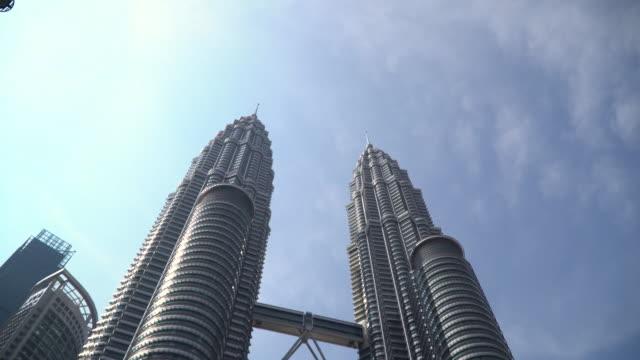 petronas twin towers in malaysia - menara kuala lumpur tower stock videos & royalty-free footage
