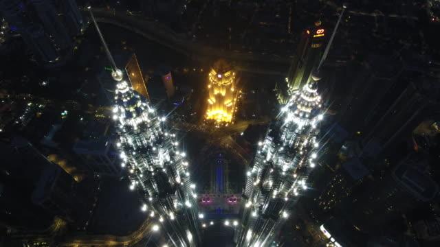petronas twin towers view from drone - menara kuala lumpur tower stock videos & royalty-free footage