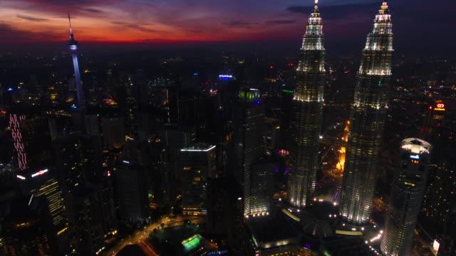 petronas twin towers view from drone - menara kuala lumpur tower stock videos and b-roll footage