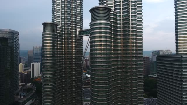 petronas twin towers view from drone - petronas twin towers stock videos and b-roll footage