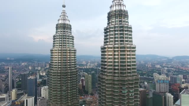 petronas twin towers view from drone - petronas towers stock videos and b-roll footage