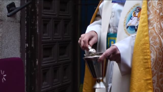 pets are being blessed by a priest at san anton church in madrid spain on saint anthony's day dedicated to the animals by spanish christians on... - priest stock videos & royalty-free footage