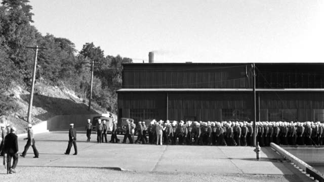 petty officers march u.s. navy recruits in formation near a naval training center building. - recruit stock videos & royalty-free footage