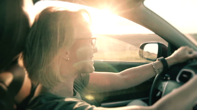 petty woman driving a car at sunset - land vehicle stock videos & royalty-free footage