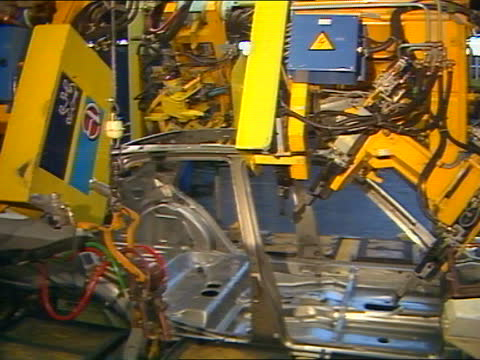"west midlands: coventry: cms tony lloyd intvw sof: ""i don't think the talbot name -- with it"" production line, as chassis lowered to workmen workmen... - コベントリー点の映像素材/bロール"