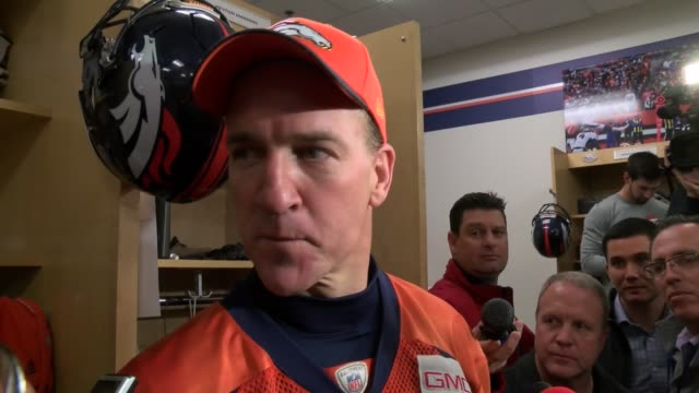 peyton manning held a locker room interview with the press after being denver broncos starting quarterback for the playoffs. - playoffs stock videos & royalty-free footage