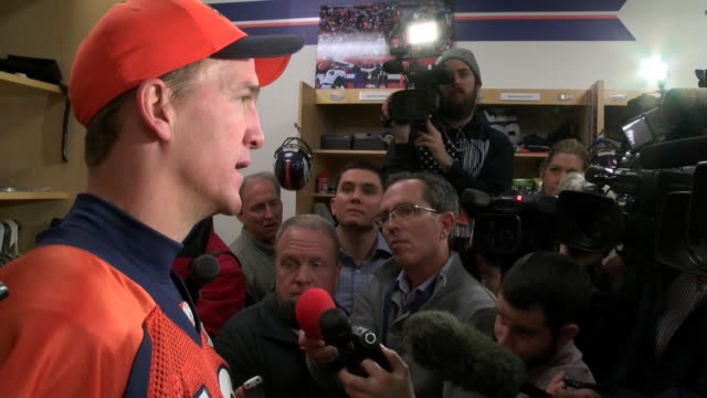 peyton manning holds locker room interview with the press gathering after being named denver broncos starting quarterback for the playoffs - playoffs stock videos & royalty-free footage