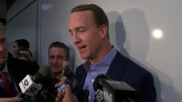 peyton manning spoke to the press in a locker room interview after he engineered a comeback win over the san diego chargers in the season finale to... - playoffs stock videos & royalty-free footage