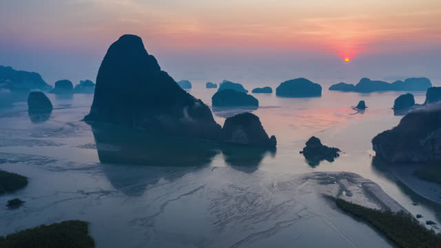 phang-nga bay in sunrise time with hyperlapse shot - fog stock videos & royalty-free footage