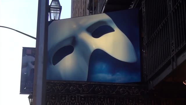 phantom of the opera marquee and 25 years on broadway, two shots. - theatre banner commercial sign stock videos & royalty-free footage