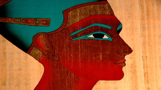 vidéos et rushes de pharaoh wearing blue crown cu modern drawing on papyrus the blue crown was worn in battles - coiffe traditionnelle
