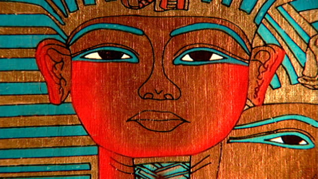pharaoh wearing nemes headdress cu modern drawing on papyrus of a pharaoh's face - headdress stock videos & royalty-free footage