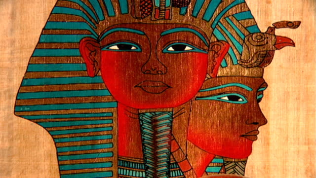 pharaoh wearing nemes headdress cu modern drawing on papyrus of two pharaoh's faces - headdress stock videos & royalty-free footage