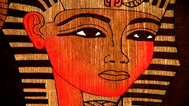 pharaoh wearing nemes headdress cu modern drawing on papyrus - headdress stock videos & royalty-free footage