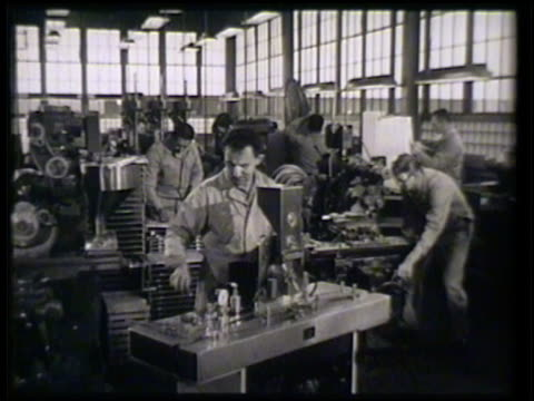 pharmaceutical industry workers operating machines male cutting large cylinder metal male w/ machine drilling machine producing medicine bottles... - metal industry stock videos & royalty-free footage