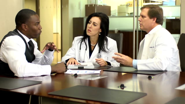 pharmaceutical representative meets with doctors - sales occupation stock videos & royalty-free footage