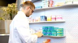 Pharmacist analyzing medicines on digital tablet