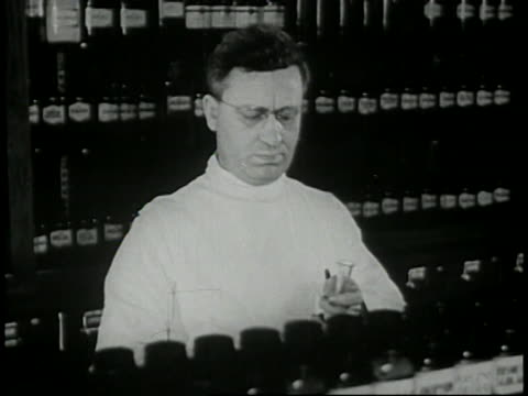 1946 - pharmacist fills prescription - prelinger stock videos & royalty-free footage