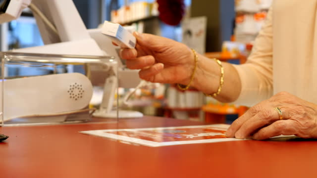 pharmacist giving medicine to customer at checkout - giving stock videos & royalty-free footage